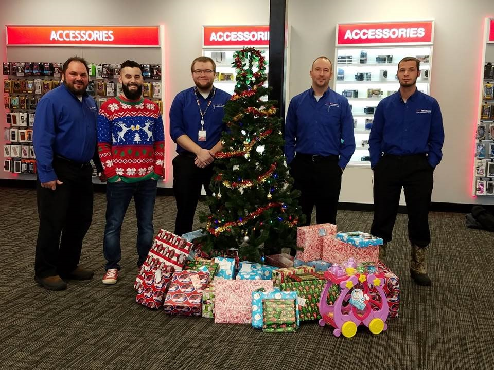 Cellular and More staff with Adopt a Family gifts